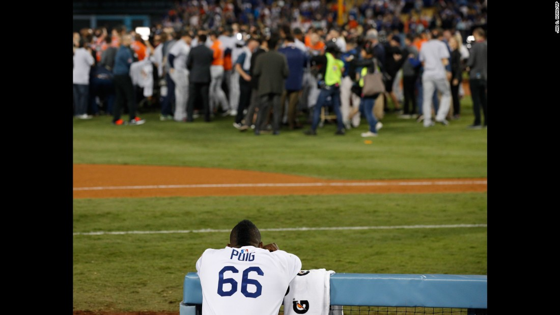 Dodgers outfielder Yasiel Puig watches the Astros celebrate.