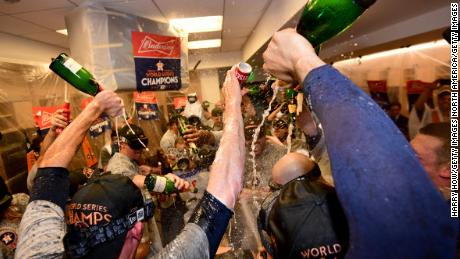 LOS ANGELES, CA - NOVEMBER 01:  The Houston Astros celebrate in the clubhouse after defeating the Los Angeles Dodgers 5-1 in game seven to win the 2017 World Series at Dodger Stadium on November 1, 2017 in Los Angeles, California.  (Photo by Harry How/Getty Images)