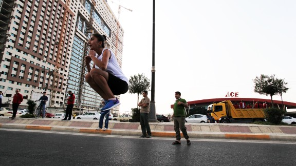 A professional Kurdish runner warms up at the start line. Some Iraqis who had made it to Erbil to run the full race were disappointed it was canceled, but organizers said they hoped to bring reinstate the 42km race next year.