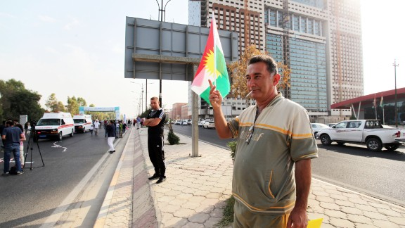 A supporter proudly waves the Kurdish flag during the race.