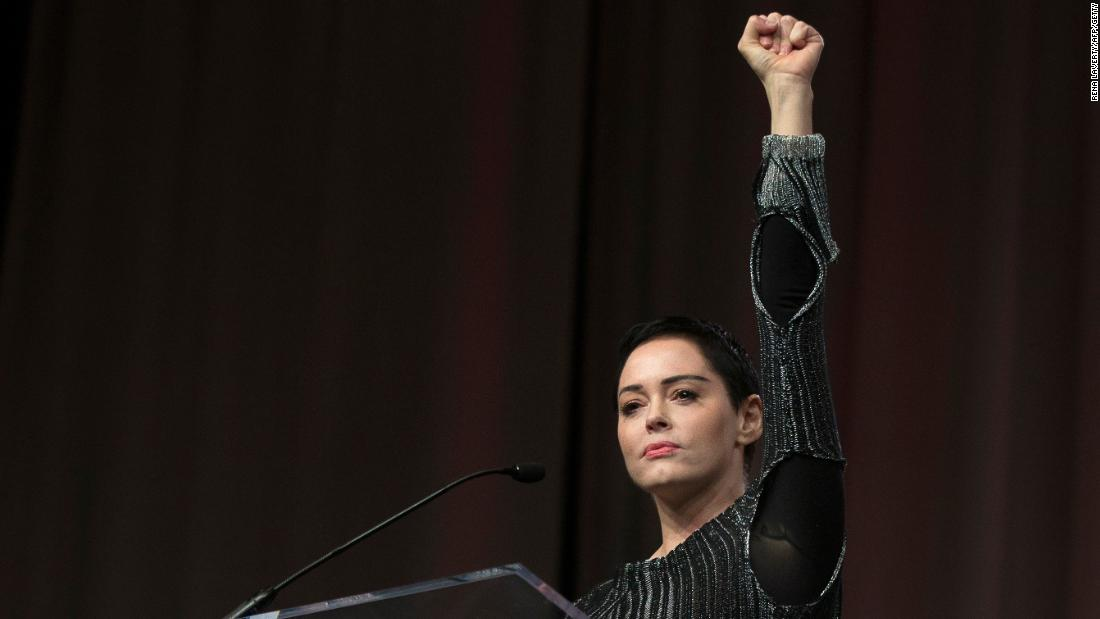 "Actress Rose McGowan raises her fist during <a href=""http://www.cnn.com/2017/10/27/entertainment/rose-mcgowan-womens-convention/index.html"" target=""_blank"">a rousing speech</a> at The Women's Convention in Detroit on Friday, October 27. It was McGowan's first public appearance since charges of sexual harassment came to light weeks ago against Hollywood mogul Harvey Weinstein. McGowan is one of dozens of women who have accused Weinstein of inappropriate behavior, including harassment and sexual assault. Weinstein, through his spokesperson, has denied ""any allegations of non-consensual sex."""