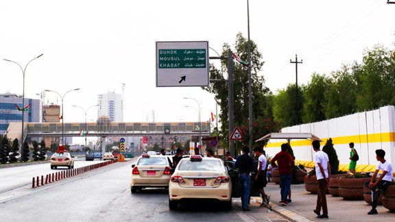 Road sign to Mosul  hangs over the Erbil International Marathon route.