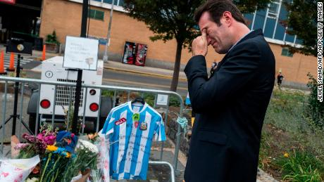 A local resident reacts after placing an Argentinian soccer jersey at a makeshift memorial for the October 31 terror attack victims along a bike path in New York, on November 2, 2017. US President Donald Trump on November 2, called for the man charged over the New York attack to be put to death after investigators said he confessed to being inspired by Islamic State group propaganda. Sayfullo Saipov, the Uzbek immigrant behind New York's worst attack in 16 years, killed eight people on October 31, plowing down a bike path with a rental truck.  / AFP PHOTO / Jewel SAMAD        (Photo credit should read JEWEL SAMAD/AFP/Getty Images)