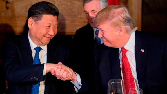 TOPSHOT - US President Donald Trump (R) and Chinese President Xi Jinping (L) shake hands during dinner at the Mar-a-Lago estate in West Palm Beach, Florida, on April 6, 2017. / AFP PHOTO / JIM WATSON        (Photo credit should read JIM WATSON/AFP/Getty Images)