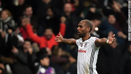 Besiktas' Ryan Babel celebrates after scoring a goal  during their UEFA Europa League round of 16 second leg football match between Besiktas JK and Olympiacos Piraeus on March 16, 2017 at the Vodafone arena stadium in Istanbul. / AFP PHOTO / BULENT KILIC        (Photo credit should read BULENT KILIC/AFP/Getty Images)
