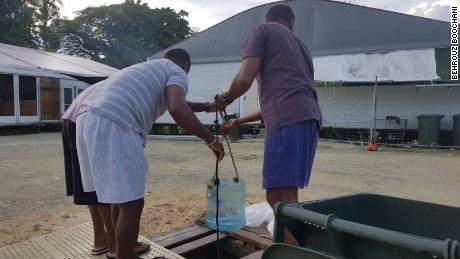 Refugees at the Manus Island detention center pull water from a well they dug in the center grounds the night before (Pic taken Friday November 3)