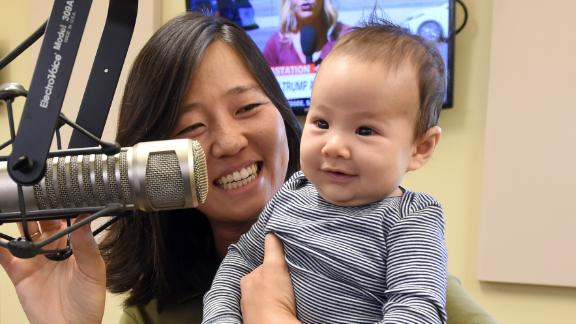 (100317  - Boston, MA) City Councilor Michelle Wu and her new baby, 11 week old Cass on Herald radio Tuesday, October 3, 2017.  Staff Photo by Arthur Pollock