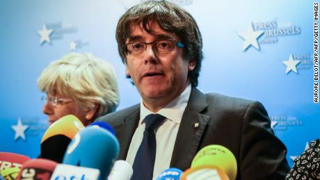 Catalonia's dismissed leader Carles Puigdemont along with other members of his dismissed government address a press conference at The Press Club in Brussels on October 31, 2017. Puigdemont, dismissed by the Spanish government on October 27 after Catalonia's parliament declared independence, reportedly drove hundreds of kilometres (miles) to Marseille in France and then flew to Belgium. / AFP PHOTO / Aurore Belot        (Photo credit should read AURORE BELOT/AFP/Getty Images)