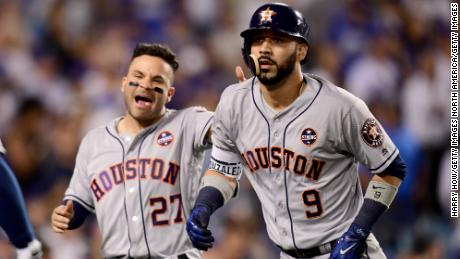 LOS ANGELES, CA - OCTOBER 25:  Marwin Gonzalez #9 of the Houston Astros celebrates with Jose Altuve #27 after hitting a solo home run during the ninth inning against the Los Angeles Dodgers in game two of the 2017 World Series at Dodger Stadium on October 25, 2017 in Los Angeles, California.  (Photo by Harry How/Getty Images)