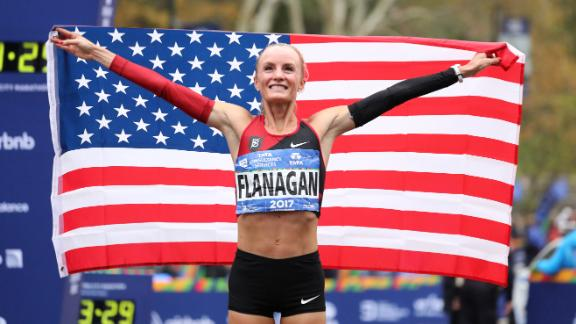 Shalane Flanagan celebrates her historic New York City Marathon victory on Sunday.