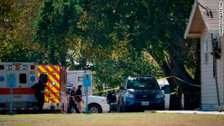 First responders work at the rear of the First Baptist Church of Sutherland Springs in response to a fatal shooting, Sunday, Nov. 5, 2017, in Sutherland Springs, Texas. (AP Photo/Darren Abate)