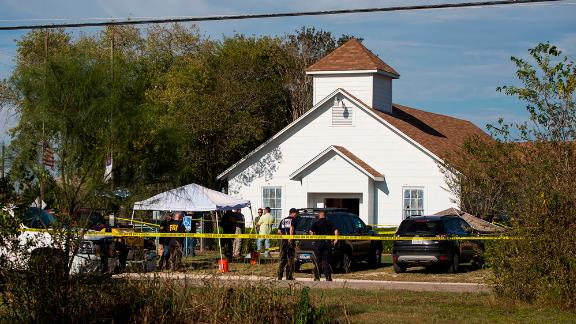 Investigators at the scene of a mass shooting at the First Baptist Church in Sutherland Springs, Texas, on Sunday, November 5, 2017. A man opened fire inside the small community church, killing at least 25 people and an unborn child. The gunman, 26-year-old Devin Patrick Kelley, was found dead in his vehicle. He was shot in the leg and torso by an armed citizen, and he had a self-inflicted gunshot to the head, authorities said.