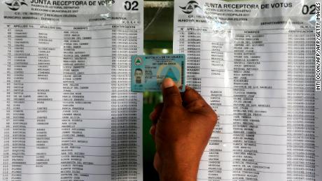A man checks the electoral register in a public school in Managua during municipal elections, on November 5, 2017.  Nicaraguans vote to elect 153 municipal mayors, 153 vice mayors and 6076 councilors.  / AFP PHOTO / Inti OCON        (Photo credit should read INTI OCON/AFP/Getty Images)