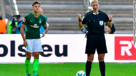 Referee Bibiana Steinhaus attends the German First division Bundesliga football match Hertha Berlin vs Werder Bremen in Berlin, on September 10, 2017. / AFP PHOTO / Tobias SCHWARZ / RESTRICTIONS: DURING MATCH TIME: DFL RULES TO LIMIT THE ONLINE USAGE TO 15 PICTURES PER MATCH AND FORBID IMAGE SEQUENCES TO SIMULATE VIDEO. == RESTRICTED TO EDITORIAL USE == FOR FURTHER QUERIES PLEASE CONTACT DFL DIRECTLY AT + 49 69 650050         (Photo credit should read TOBIAS SCHWARZ/AFP/Getty Images)