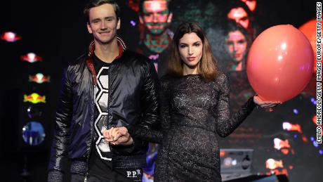 Russia's Daniil Medvedev walks down the catwalk at the Next Gen Finals draw ceremony.
