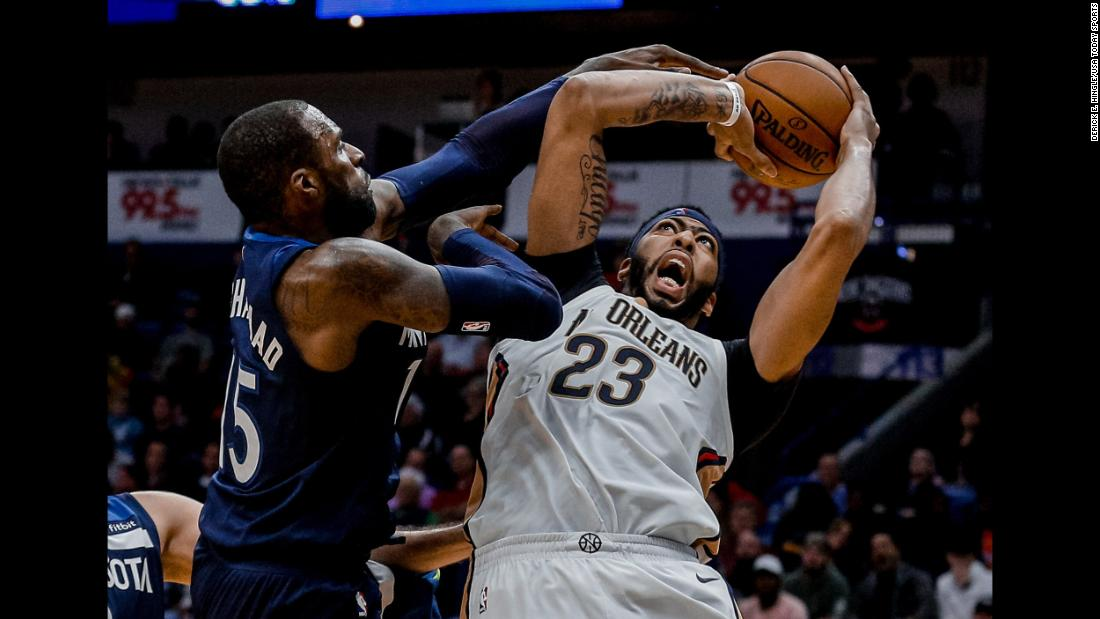 New Orleans forward Anthony Davis is defended by Minnesota's Shabazz Muhammad during an NBA game on Wednesday, November 1.