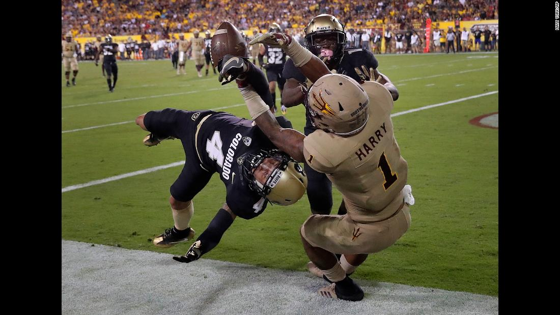 Colorado defensive back Dante Wigley, left, breaks up a pass intended for Arizona State wide receiver N'Keal Harry during a college football game in Tempe, Arizona, on Saturday, November 4.