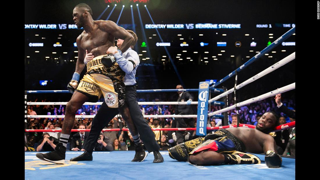 Referee Arthur Mercante pulls Deontay Wilder away from Bermane Stiverne after Wilder's first-round victory in New York on Saturday, November 4. Mercante stopped the fight after Wilder, the WBC heavyweight champion, floored Stiverne for the third time in the round.