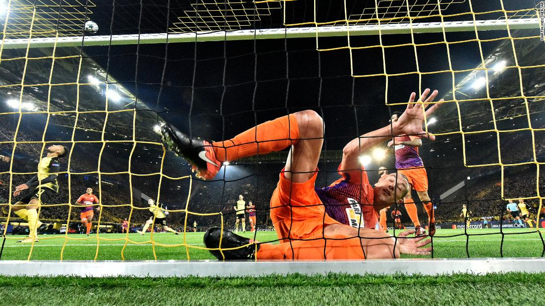 Jesus Rueda, a defender for Cypriot soccer club APOEL, falls into the goal during a Champions League match against Borussia Dortmund on Wednesday, November 1.