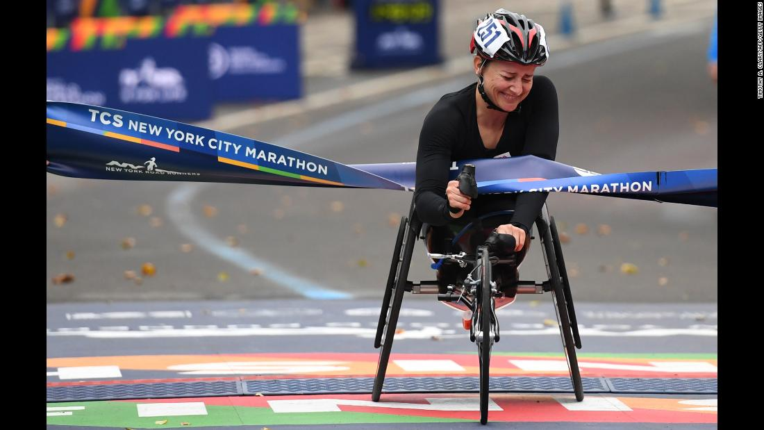 Swiss athlete Manuela Schar celebrates after she won the New York City Marathon's wheelchair division on Sunday, November 5.