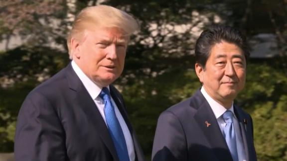 US President Donald J. Trump walks with Japan's Prime Minister Shinzo Abe on November 6, 2017