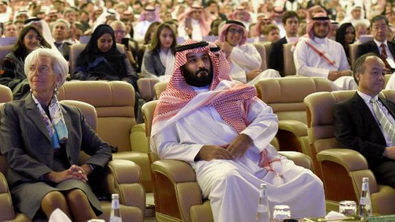 """Saudi Crown Prince Mohammed bin Salman (C) and Managing Director of International Monetary Fund Christine Lagarde (L) attend the Future Investment Initiative (FII) conference in Riyadh, on October 24, 2017. The Crown Prince pledged a """"moderate, open"""" Saudi Arabia, breaking with ultra-conservative clerics in favour of an image catering to foreign investors and Saudi youth.  """"We are returning to what we were before -- a country of moderate Islam that is open to all religions and to the world,"""" he said at the economic forum in Riyadh.  / AFP PHOTO / FAYEZ NURELDINE        (Photo credit should read FAYEZ NURELDINE/AFP/Getty Images)"""