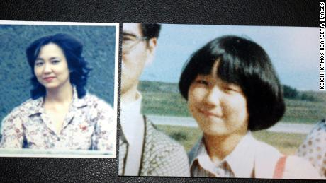OCTOBER 3: Photographs of Japanese abductee, Megumi Yokota, at 13 (R) and at 20, taken in North Korea, is shown at a news conference October 3, 2002 in Tokyo, Japan. Yokota was the youngest national kidnapped, abducted on her way home from badminton practice. She and other nationals were abducted in the 1970s and 80s to teach Japanese language and customs in spy schools in North Korea. (Photo by Koichi Kamoshida/Getty Images)