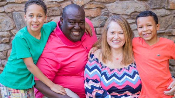Michaela Sims Stewart, who goes by her maiden name professionally, thanks the adoption tax credit for allowing her and her husband Jon to bring Sam, left, and Jack into their family.