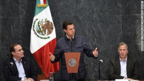 Mexican President Enrique Pena Nieto (C) speaks along Juan Pablo Castanon (L) from the Consejo Coordinador Empresarial (Businessmen's Coordinating Council) and Mexican Finance Minister Jose Antonio Meade (R) during a message on the most recent earthquake, in Mexico City on September 27, 2017.  Faced with a tragedy that battered the city and claimed more than 300 lives, Mexico put its best foot forward, responding with an explosion of civic action. / AFP PHOTO / ALFREDO ESTRELLAALFREDO ESTRELLA/AFP/Getty Images