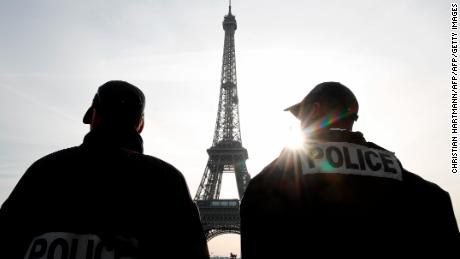 Police patrol in front of the Eiffel Tower in Paris last week as France officially ended a state of emergency.