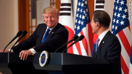 U.S. President Donald Trump, left, smiles with South Korean President Moon Jae-In during a joint press conference at the presidential Blue House in Seoul, South Korea, Tuesday, Nov. 7, 2017. (Jung Yeon-Je/Pool Photo via AP)