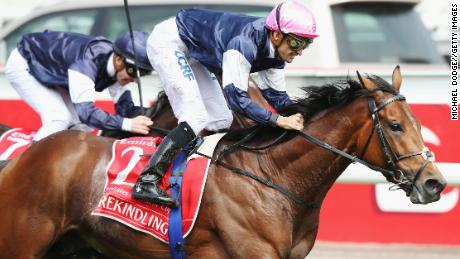 Corey Brown riding Rekindling wins the Melbourne Cup at Flemington Racecourse on November 7 in Melbourne.