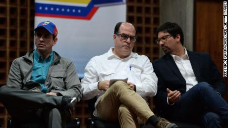 "(L-R) Venezuelan senior opposition leader Henrique Capriles, the leader of the opposition-controlled legislature, Julio Borges, and the legislature's first vice-president Freddy Guevara listen to dismissed chief prosecutor Luisa Ortega (out of frame), during the ""In Defence of Democracy Forum"" held by the opposition in Caracas on August 6, 2017 a day after a new assembly with supreme powers and loyal to President Nicolas Maduro started functioning and fired Ortega. Ortega has been a thorn in Maduro's side for months, breaking ranks with him over the legality of the Constituent Assembly, which was elected last week in a vote marred by violence and fraud allegations. She refused to recognize her sacking, or the assembly's swearing in of Tarek William Saab, the national ombudsman, in her place.  / AFP PHOTO / Federico PARRA        (Photo credit should read FEDERICO PARRA/AFP/Getty Images)"