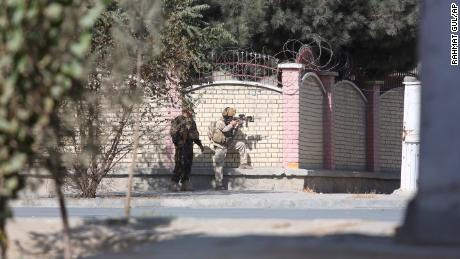 Afghan security personnel take a position near the Shamshad Television after an attack in Kabul, Afghanistan, Tuesday, Nov. 7, 2017.