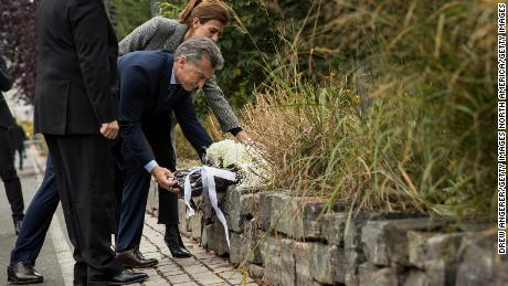 NEW YORK, NY - NOVEMBER 06: (L to R) Argentinian President Mauricio Macri and First Lady of Argentina Juliana Awada lay flowers as they attend a tribute for the victims of last week's vehicular attack on the bike path next to the West Side Highway in Lower Manhattan, November 6, 2017 in New York City. Eight people were killed last Tuesday when a man drove a truck onto a bike path in Lower Manhattan. Five of the victims were from Argentina. (Drew Angerer/Getty Images)