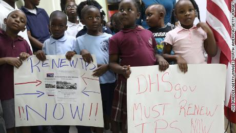 MIAMI, FL - NOVEMBER 06:  Children hold posters asking the Federal government to renew  Temporary Protected Status during a press conference about TPS for people from Haiti, Honduras, Nicaragua and El Salvador at the office of the Haitian Women of Miami in the Little Haiti neighborhood on November 6, 2017 in Miami, Florida. The U.S. Department of Homeland Security is nearing a decision on the plans for TPS recipients. Last week Secretary of State Rex Tillerson sent a letter to DHS possibly signaling a decision to remove the immigrants' protected status, telling them that conditions in Central America and Haiti no longer required them to be exempted from deportation. (Photo by Joe Raedle/Getty Images)