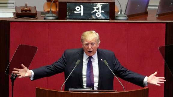 """U.S. President Donald Trump delivers a speech as South Korea's National Assembly Speaker Chung Sye-kyun, top, listens at the National Assembly in Seoul, South Korea, Wednesday, Nov. 8, 2017. President Trump told South Korea's National Assembly that he wants """"peace through strength.""""  The U.S. president addressed South Korean lawmakers on the second day of his visit. He noted that the U.S. is rebuilding its military and spending heavily on the newest and finest military equipment.(AP Photo/Lee Jin-man, Pool)"""