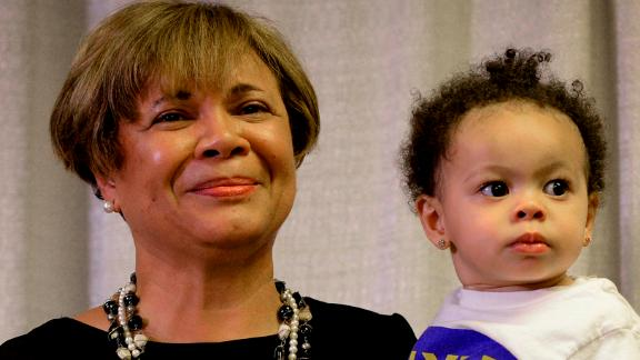 Vi Lyles, Charlotte's Democratic mayor pro tem, listens to the applause of supporters with her granddaughter following her victory on Tuesday.