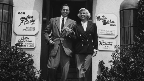 Day, with husband and manager Marty Melcher, outside his talent agency in Hollywood, circa 1960.