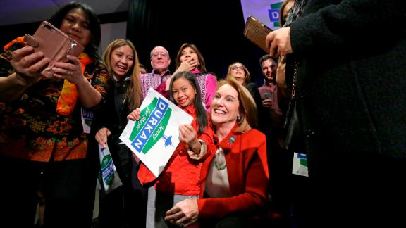 Seattle mayoral candidate Jenny Durkan poses for photos with supporters at an election night party Tuesday, Nov. 7, 2017, in Seattle.