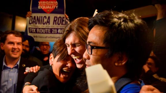Danica Roem, center, a Democrat who ran for Virginia's House of Delegates against GOP incumbent Robert Marshall, is greeted by supporters as she prepares to give her victory speech Tuesday, Nov. 7, 2017, in Manassas, Va. Roem, a former journalist, is set to make history as the first openly transgender person elected and seated in a state legislature in the United States. (Jahi Chikwendiu/The Washington Post via AP)