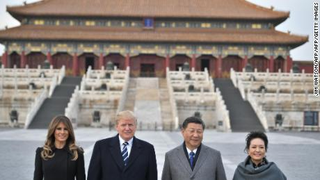 "(From L to R) US President Donald Trump, First Lady Melania Trump, China's President Xi Jinping and his wife Peng Liyuan pose in the Forbidden City in Beijing on November 8, 2017. US President Donald Trump arrived in Beijing on November 8 for the critical leg of his Asia tour to drum up an uncompromising, global front against the nuclear weapons ambitions of the ""cruel dictatorship"" in North Korea. / AFP PHOTO / Jim WATSON        (Photo credit should read JIM WATSON/AFP/Getty Images)"