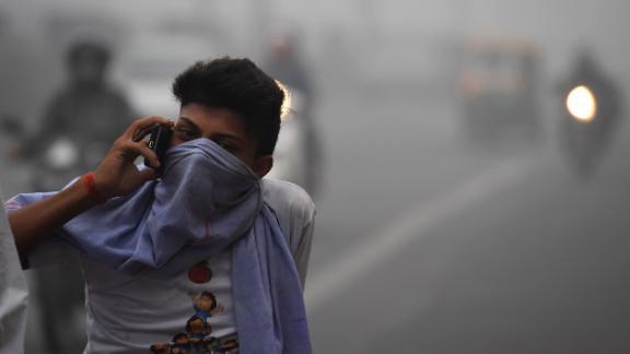 A Delhi commuter talks on a phone amid heavy smog November 8, 2017.