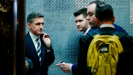 "FILE- In this Nov. 17, 2016, file photo, retired Lt. Gen Michael Flynn, left, his son Michael G. Flynn, second from left, and Boris Epshteyn, a spokesman for President-elect Donald Trump, third from left, board an elevator at Trump Tower in New York. Michael G. Flynn tweeted about the false idea that prompted a shooting at a Washington, D.C., pizza parlor. Vice President-elect Mike Pence acknowledged Tuesday, Dec. 6, that the younger Flynn was helping his father with scheduling and administrative items during the presidential transition but told CNN ""that's no longer the case."" (AP Photo/Carolyn Kaster, File)"