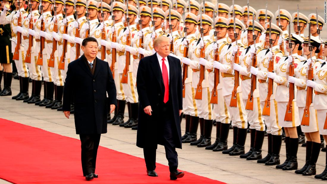 "US President Donald Trump and XI take part in a welcome ceremony at the Great Hall of the People on Thursday, November 9, 2017, in Beijing during <a href=""http://www.cnn.com/interactive/2017/11/politics/trump-asia-tour-cnnphotos/index.html"" target=""_blank"">Trump's visit to Asia. </a>"