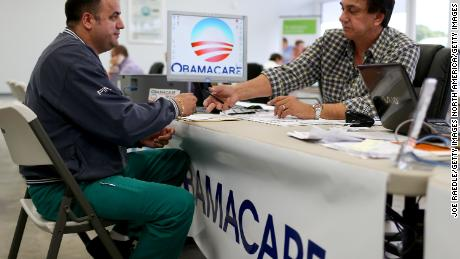 MIAMI, FL - FEBRUARY 05:  Ariel Fernandez (L) sits with Noel Nogues, an insurance  advisor with UniVista Insurance company, as he signs up for the Affordable Care Act, also known as Obamacare, before the February 15th deadline on February 5, 2015 in Miami, Florida. Numbers released by the government show that the Miami-Fort Lauderdale-West Palm Beach metropolitan area has signed up 637,514 consumers so far since open enrollment began on Nov. 15, which is more than twice as many as the next large metropolitan area, Atlanta, Georgia.  (Photo by Joe Raedle/Getty Images)