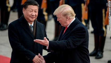 China's President Xi Jinping (L) and US President Donald Trump attend a welcome ceremony at the Great Hall of the People in Beijing on November 9, 2017.  / AFP PHOTO / FRED DUFOUR        (Photo credit should read FRED DUFOUR/AFP/Getty Images)