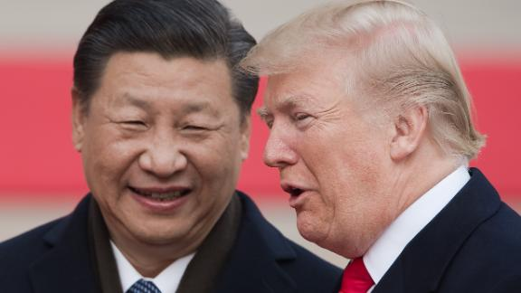 China's President Xi Jinping (L) and US President Donald Trump attend a welcome ceremony at the Great Hall of the People in Beijing on November 9, 2017. / AFP PHOTO / NICOLAS ASFOURI        (Photo credit should read NICOLAS ASFOURI/AFP/Getty Images)