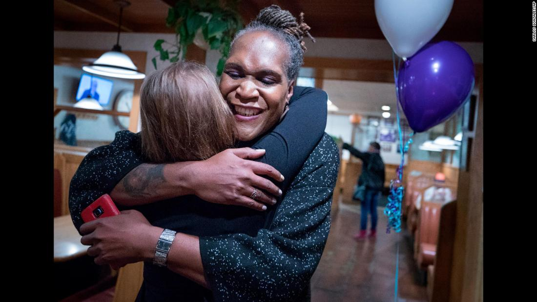 "Andrea Jenkins hugs a supporter after winning a spot on the Minneapolis City Council on Tuesday, November 7. Jenkins is the first openly transgender person of color to be elected to public office in the United States. <a href=""http://www.cnn.com/2017/11/08/us/election-firsts-lgbt-minorities/index.html"" target=""_blank"">Read more: Election night brings historic wins for minority and LGBT candidates</a>"