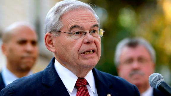 U.S. Sen. Bob Menendez speaks on the yard of Peter Tom, a New Jersey resident, during a news conference talking about the tax-overhaul plan unveiled by House Republicans, Friday, Nov. 3, 2017, in Bloomfield, N.J. (AP Photo/Julio Cortez)